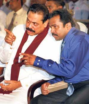 President Mahinda Rajapaksa with Minister Vinayagamoorthy Muralitharan (file pic)