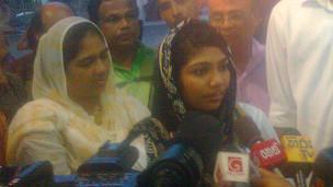 Amina Salley talking to media