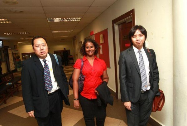 Lena Hendry (C) is flanked by her lawyers Andrew Khoo (L) and New Sin Yew in the court grounds.