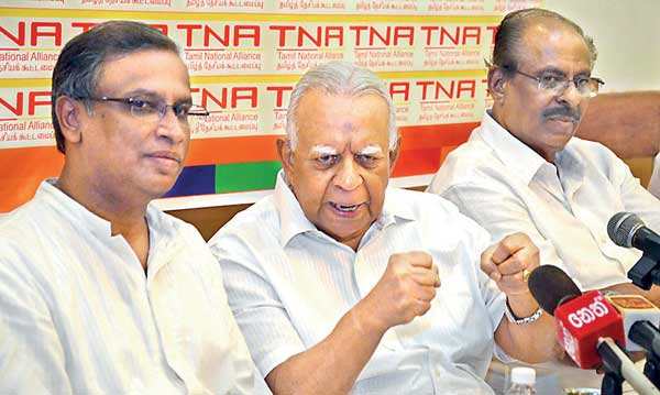 TNA Leader R. Sampanthan (centre) gestures at the news conference yesterday in Colombo flanked by MPs M.A. Sumanthiran (left) and Mavai Senathiraja – Pic by Kithsiri De Mel-courtesy: DailyFT