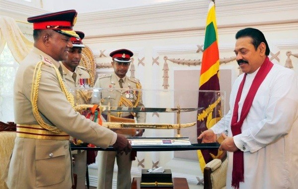 Lieutenant General Daya Ratnayake, as new Commander of the Army Pays Courtesy Call on President Rajapaksa-in Aug 2013-pic: News.lk