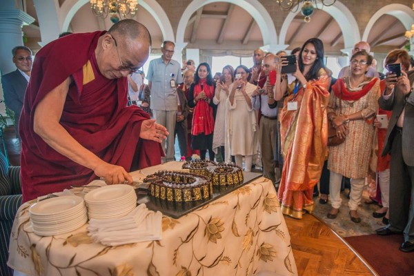 His Holiness the Dalai Lama cuts the first birthday cake of his 80th year to share with Indian friends in New Delhi, India on March 22, 2015. (Photo by Tenzin Choejor/OHHDL)-via: facebook.com/DalaiLama