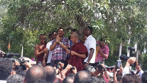 Basil Rajapaksa listening to seth pirith before addressing nearly 5,000 supporters who arrived at Katunayake to wecome him on April 21
