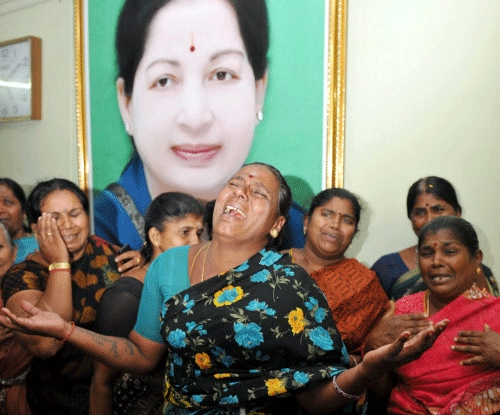 Supporters of AIADMK Supremo J Jayalalitha weep after her conditional bail was rejected by the Bangalore court, in Coimbatore on Tuesday. PTI Photo
