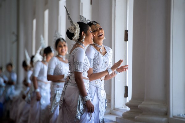 Two Women in Traditional Kandyan Dress Laugh While Waiting as Secretary Kerry Meets With Sri Lankan Foreign Minister Samaraweera-pic: US State Dept.