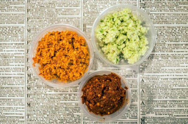 Counterclockwise from top right: minchi sambol, a beautifully bright paste of fresh grated coconut and lime; pol sambol, a tumble of red onion and tomato; and racked by chile, the ruthless conflagration that is lunu sambol.