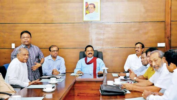 Former President Mahinda Rajapaksa at the head of the table at the SLFP's Darley Road headquarters, flanked by the two General Secretaries of the SLFP and the UPFA
