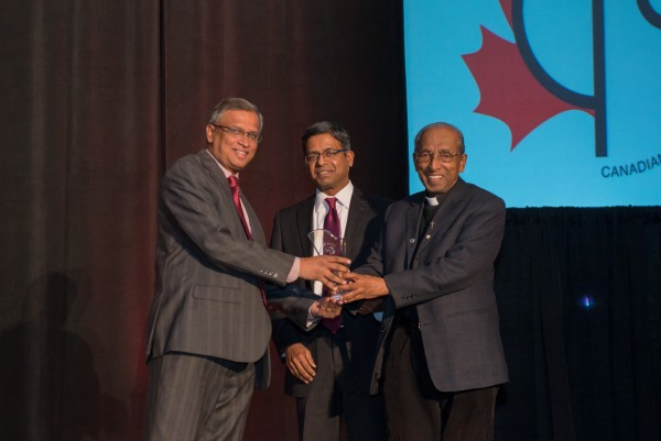 "MA Sumanthiran MP accepts ""Living Hero"" award on behalf of TNA leader R. Sampanthan at Canadian Tamil Congress Thai Pongal event in Toronto-Jan 16, 2016"