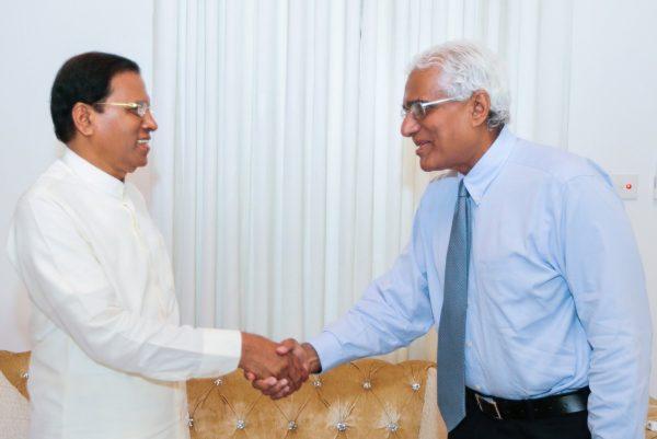 President Maithripala Sirisena greeting Dr. Indrajit Coomarswamy-pic via: twitter.com/MaithripalaS