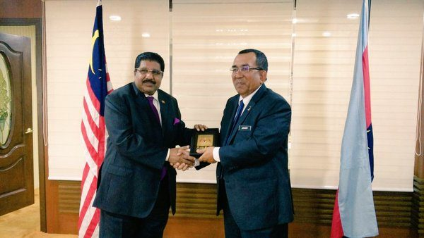 High Commissioner Ibrahim Ansar in a courtesy call with Mohd Johari Baharum is a member of the governing United Malays National Organisation (UMNO) party~ pic: twitter.com/mjoharibaharum